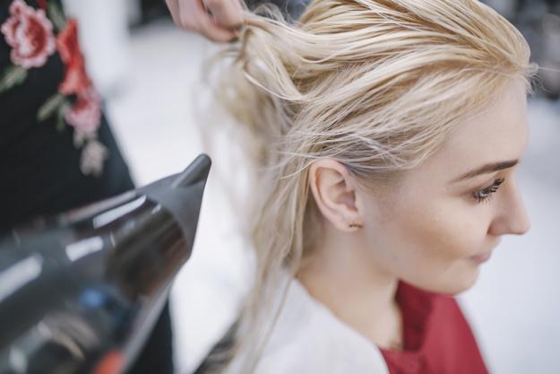 crop-hairstylist-using-dryer_23-2147769810