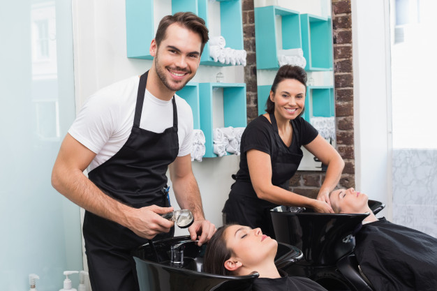 hairdressers-washing-their-clients-hair_13339-77802