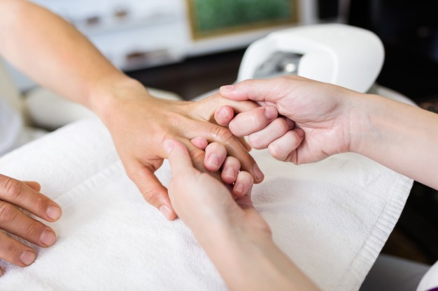 young-man-doing-manicure-in-salon-beauty-concept_1301-3367